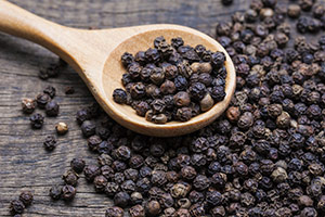black pepper spreaded out of a spoon