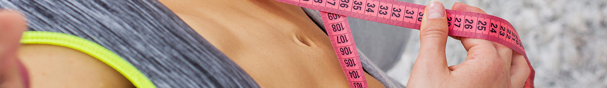banner showing a woman with a flat stomach measuring her waist