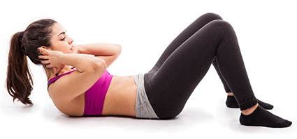 Woman performing a sit up a gyme exercise used to lose belly fat