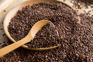 bowl of overloaded flaxseeds with a spoon