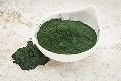 image of a bowl with ground green magic powder and next to it