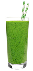 glass of a smoothie made from spirulina powder with ingredients