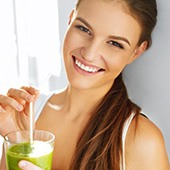 Smiling Woman With Healthy Drink made with guarana powder
