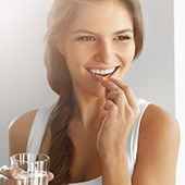 picture of a woman smiling while taking a tablet showing that shes happy
