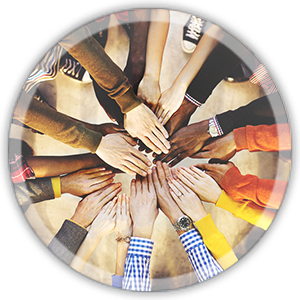 people in a circle with hands in the middle to show diversity