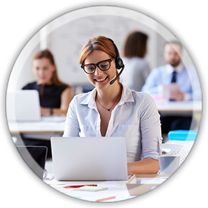 office woman at a desk working weaaring a headset smiling