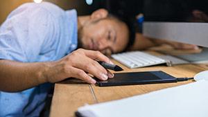 Man FAllen Asleep At His Desk