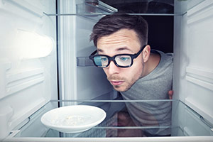 Man Looking Inside Fridge