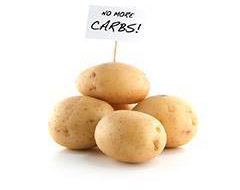 photograph of potatoes with a no more carbs sign on them