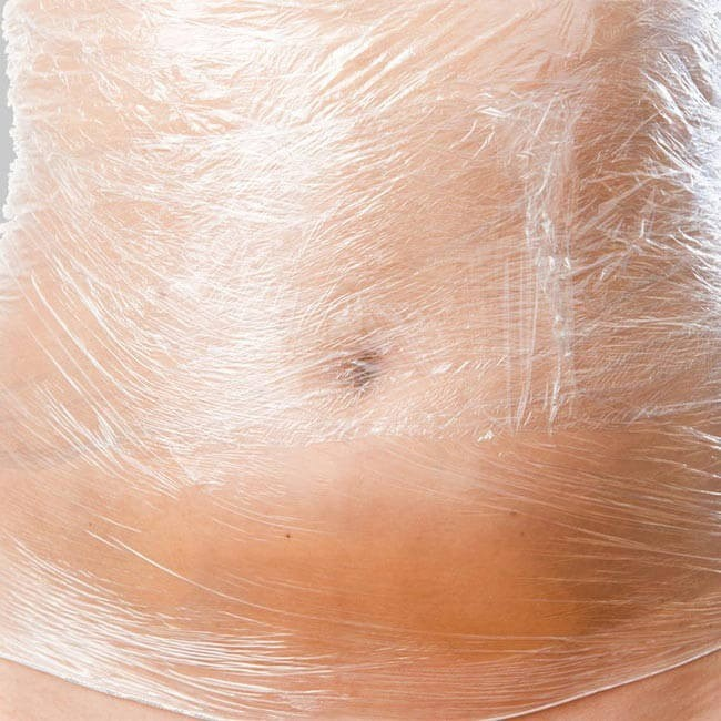 image of womans stomach wrapped in cling film to show bdy wraps
