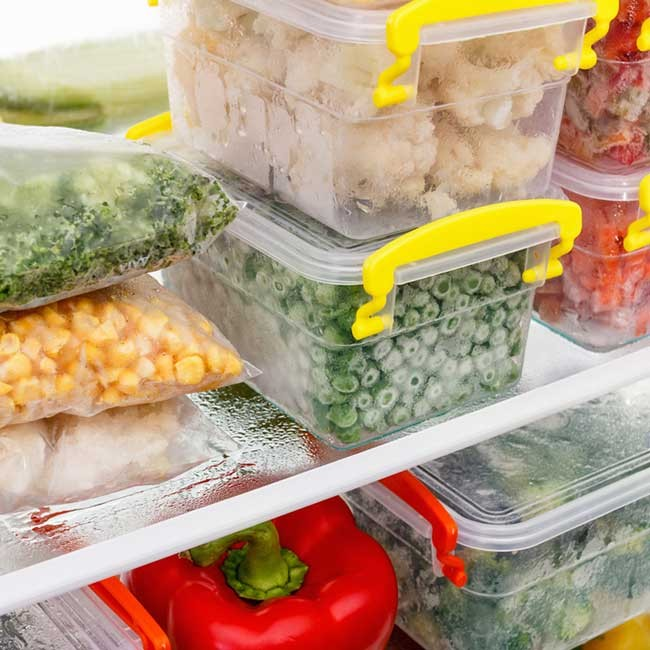 food in containers and tubs in the fridge to represent meal prep