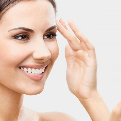 woman touching her face to represent someone who has a beauty regime