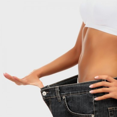 image of woman with skinny waist and oversized jeans