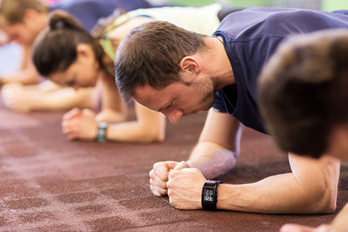 photograph of men and women doing the plank exercise number 4