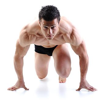 Man with Muscles Ready to Sprint to show muscle support powder