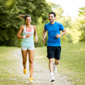 two young man and woman running to show healthy lifestyle