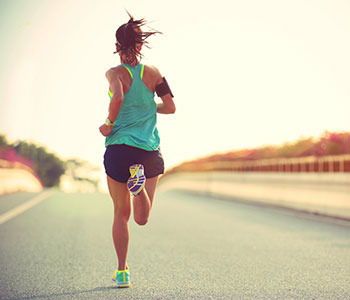 woman running on a road with running clothes to encourage you to start exercise