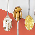 image of spoons holding softgels capsules and tablets
