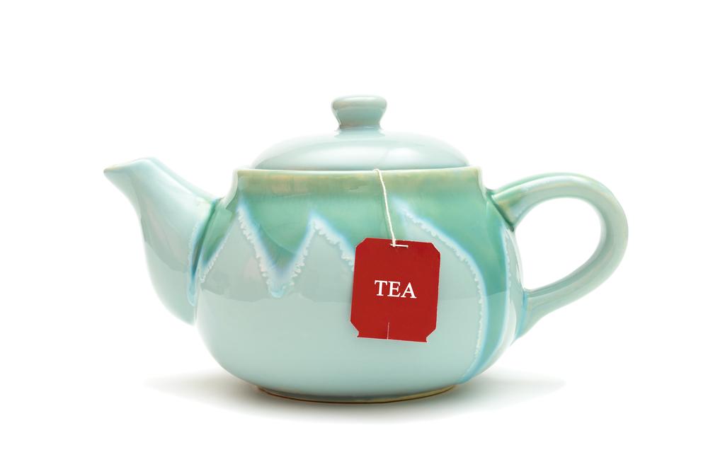 teapot-tea-bags-isolated-on-white
