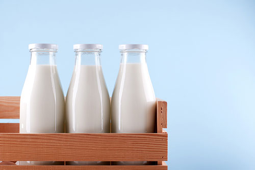 three bottles of milk to represent whole skimmed and semi skimmed milk