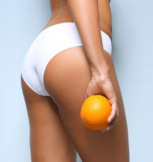 Woman Holding An Orange