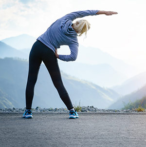 Woman Stretching Before A Run