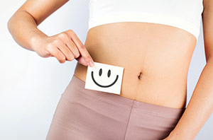 Woman With Smiley Face Sticker