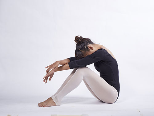 image of woman doing yoga which is exercise number 3